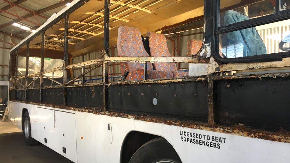 Bus frame rust repairs have begun!