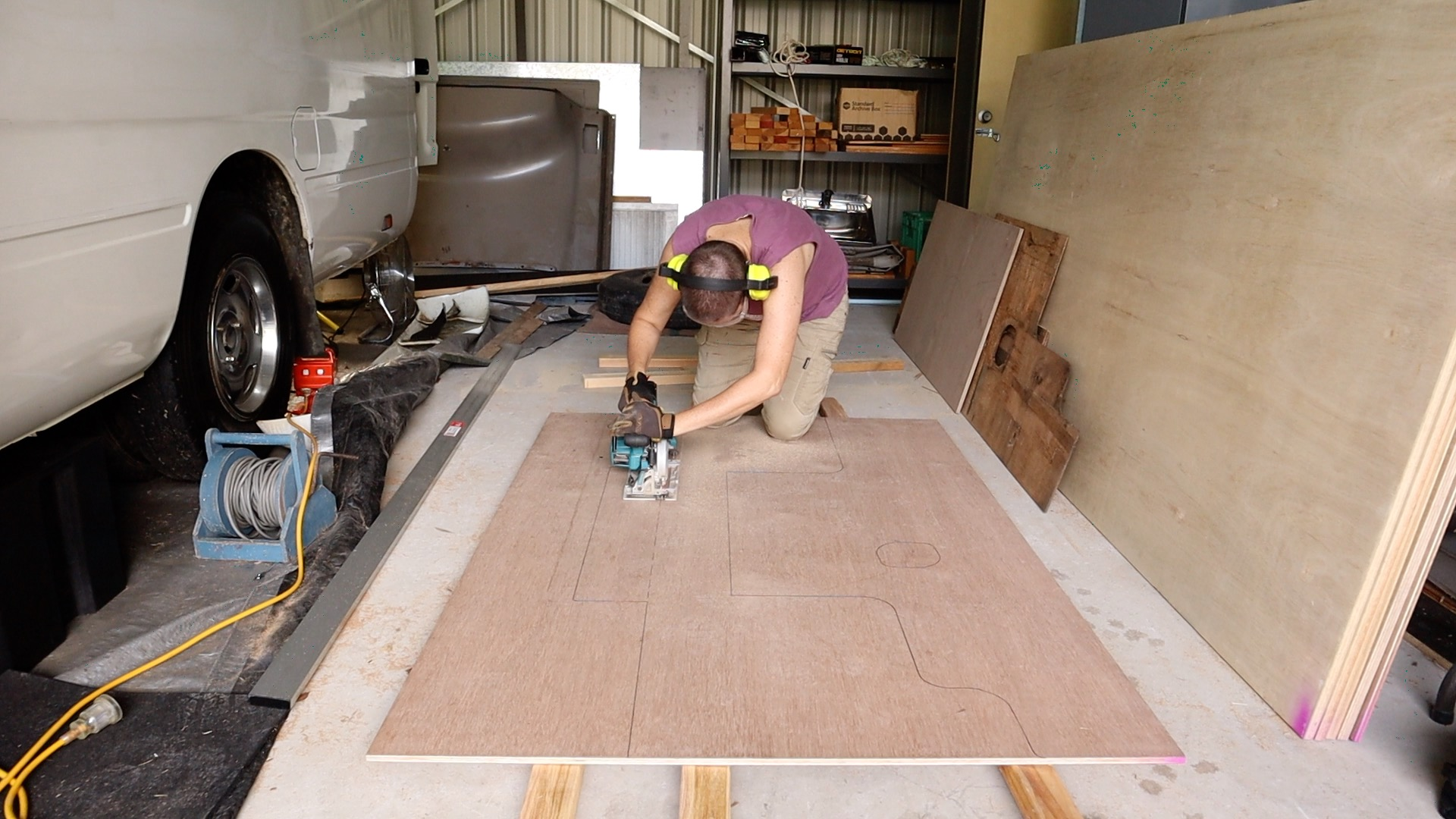 cutting out the plywood for the floor