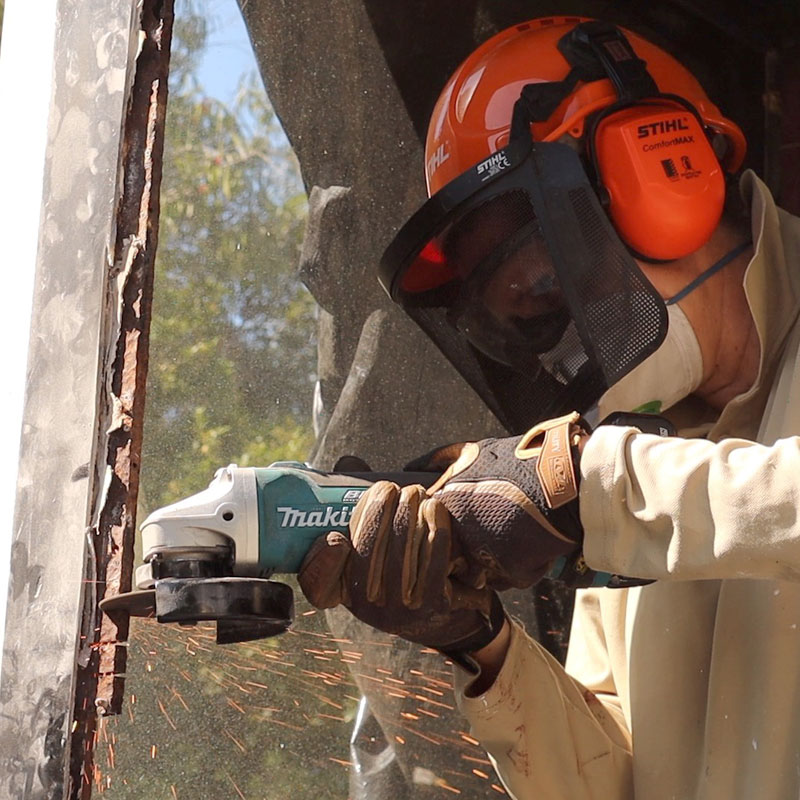 cutting out rusted metal